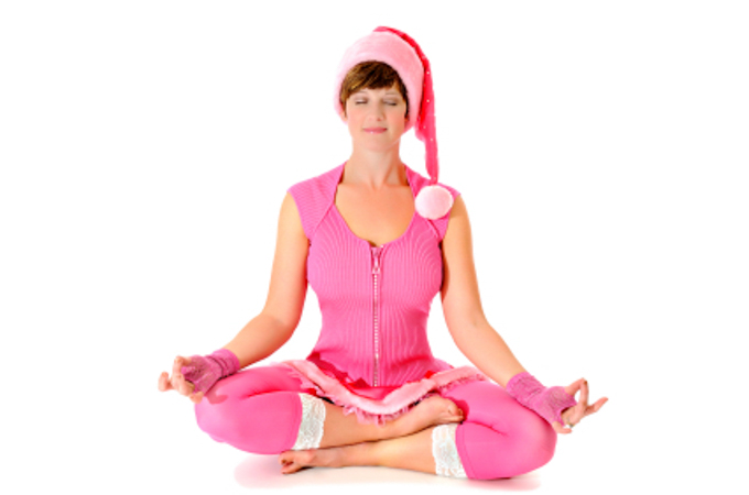 Santa Baby Woman All In Pink! Sitting In Lotus Position. Isolated On White. space For Copy.