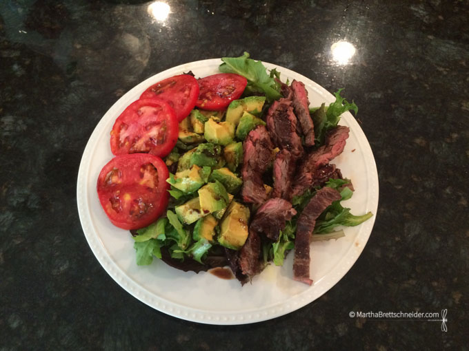 Flank steak, avocado, and tomatoes drizzled with fig vinegar and lime-infused olive oil.
