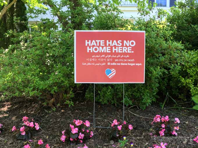 Hate Has No Home Here sign practicing mindfulness